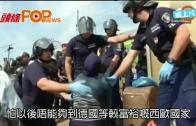 (粵)敘難民推妻兒 臥火車軌抗議