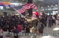 女子不滿揮美國旗 與集會人士口角爭執